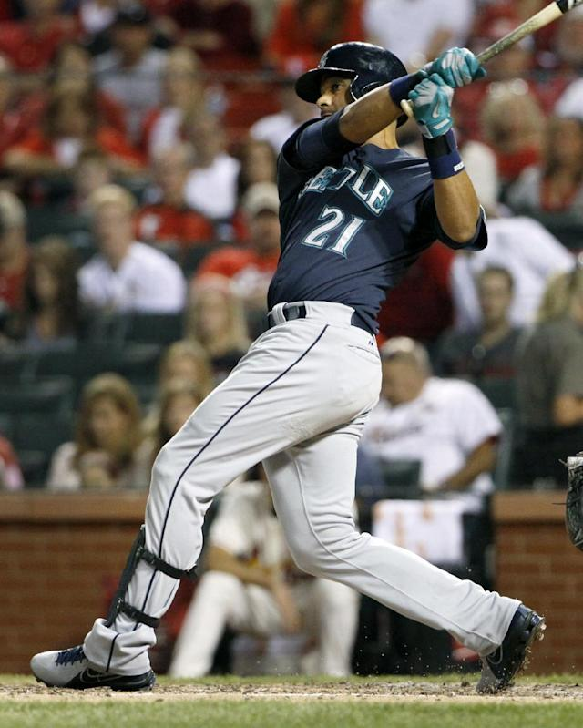 Seattle Mariners' Franklin Gutierrez follows through on a two-run double during the fifth inning of a baseball game against the St. Louis Cardinals, Saturday, Sept. 14, 2013, in St. Louis. (AP Photo/Jeff Roberson)