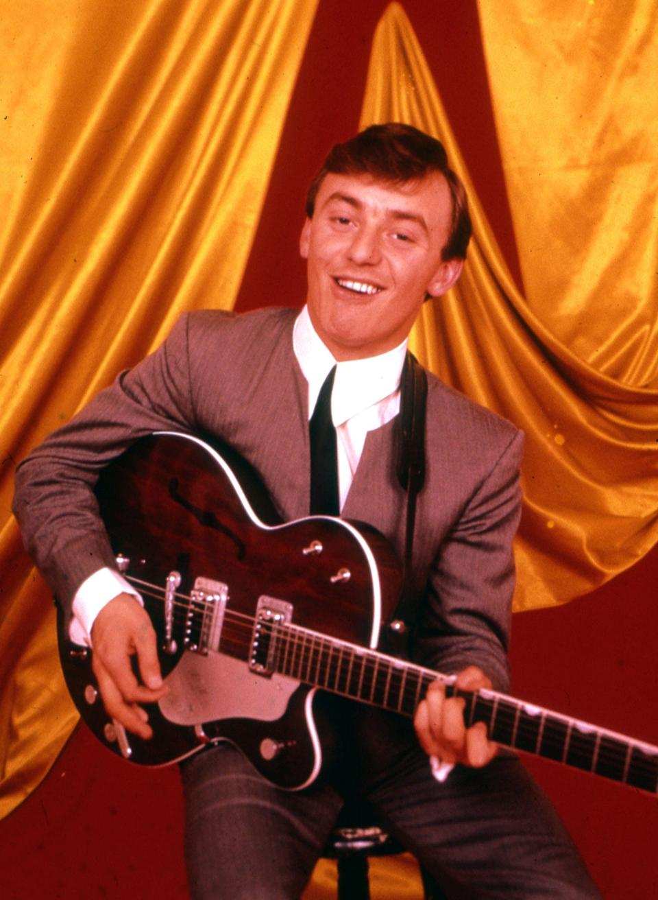 In 1963, the year he and the band topped the charts three times and toured the UK with Roy Orbison and the Beatles - Alamy