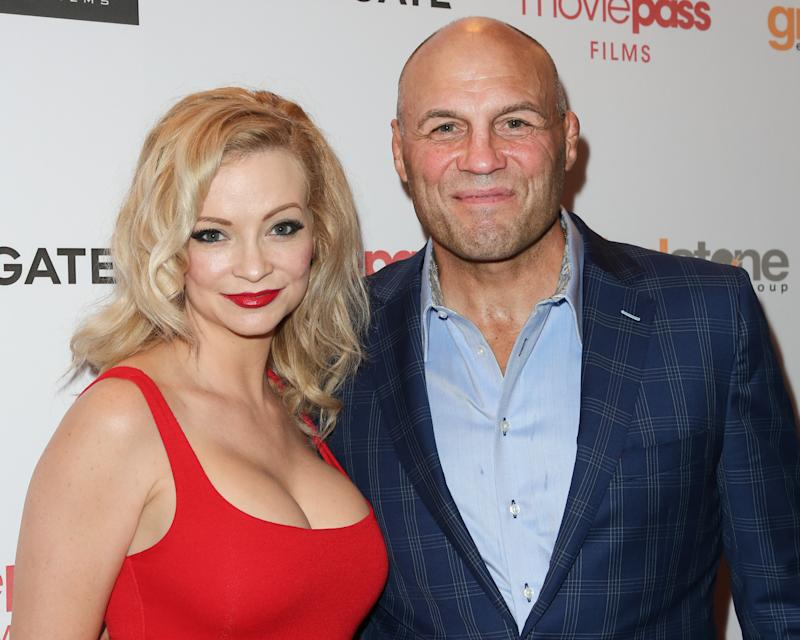 "WEST HOLLYWOOD, CA - JULY 25: Actors Mindy Robinson (L) and Randy Couture (R) attend the Los Angeles premiere of ""The Row"" at Sunset 5 on July 25, 2018 in West Hollywood, California. (Photo by Paul Archuleta/Getty Images)"