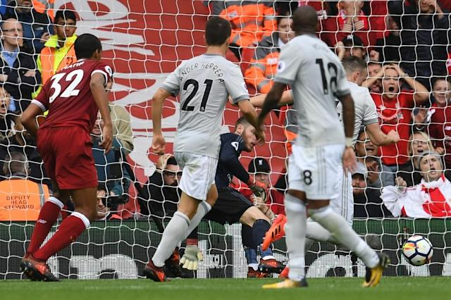 Manchester United's Spanish goalkeeper David de Gea (centre) saves a shot from Liverpool's Cameroonian defender Joel Matip during their English Premier League match at Anfield in Liverpool on October 14, 2017 (AFP Photo/Paul ELLIS)