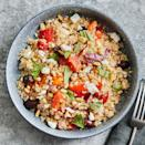 """<p>This quinoa salad, which takes loose inspiration from a Greek salad, is flavorful and filling. Broiling the olives along with the other vegetables softens their flavor and adds a smoky background note. A garnish of basil brightens the dish. <a href=""""https://www.eatingwell.com/recipe/7893499/quinoa-salad-feta-olives-tomatoes/"""" rel=""""nofollow noopener"""" target=""""_blank"""" data-ylk=""""slk:View recipe"""" class=""""link rapid-noclick-resp""""> View recipe </a></p>"""