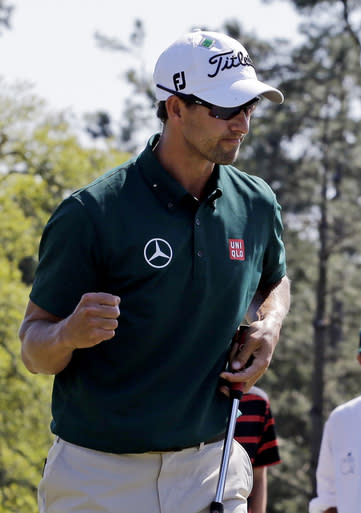Adam Scott, of Australia, punches the air after making par on the 18th hole during the first round of the Masters golf tournament Thursday, April 10, 2014, in Augusta, Ga. (AP Photo/David J. Phillip)