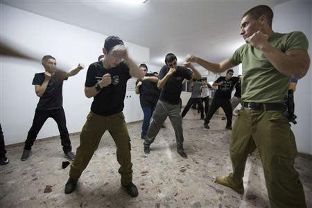 Ultra-Orthodox Jewish youths take part in an Israeli martial arts training lesson in Mevasseret Zion, near Jerusalem, October 14, 2013. REUTERS/Baz Ratner