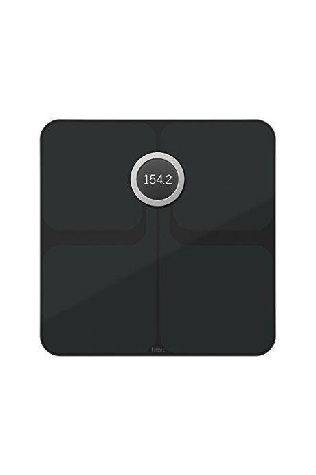 """<p><strong>Fitbit</strong></p><p><strong>$389.90</strong></p><p><a href=""""https://www.amazon.com/Fitbit-Aria-Wi-Fi-Smart-Scale/dp/B0752M6T6K?tag=syn-yahoo-20&ascsubtag=%5Bartid%7C10055.g.2108%5Bsrc%7Cyahoo-us"""" rel=""""nofollow noopener"""" target=""""_blank"""" data-ylk=""""slk:Shop Now"""" class=""""link rapid-noclick-resp"""">Shop Now</a></p><p>This sleek, advanced glass scale is great for Fitbit users — it integrates directly with your Fitbit app, so you can see all of your fitness and health information in one place. It <strong>tracks BMI, body fat percentage and lean mass</strong> and stores up to eight profiles. Good to know: You can't turn off the bioimpedance feature (which helps measure body fat percentage) so opt for a different one if you're pregnant. </p>"""