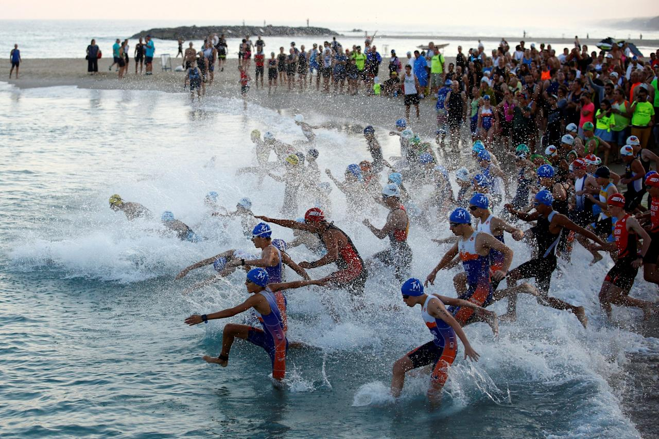 <p>Participants jump into the water in the Mediterranean Sea as they take part in a triathlon in Ashkelon, Israel June 16, 2017. REUTERS/Amir Cohen </p>