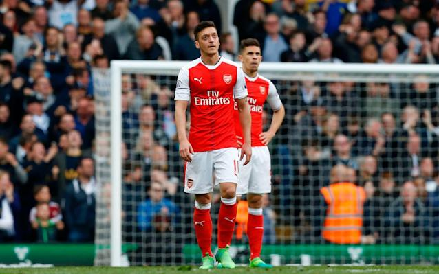 <span>Ozil looks to the heavens after Tottenham's first goal</span> <span>Credit: AFP </span>