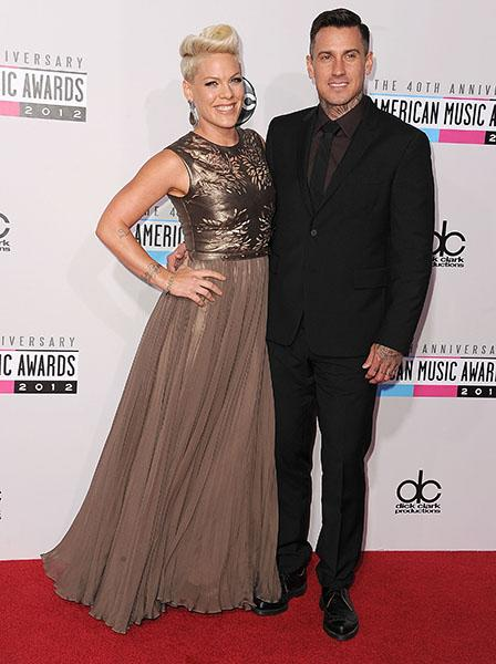 Who says tough girls can't be sweet and romantic? P!nk showed up to the 2012 American Music Awards in a pretty much perfect Catherine Deane gown with a laser-cut leather bodice and flowy skirt. She accessorized with some handsome arm candy--hubby Carey Hart.
