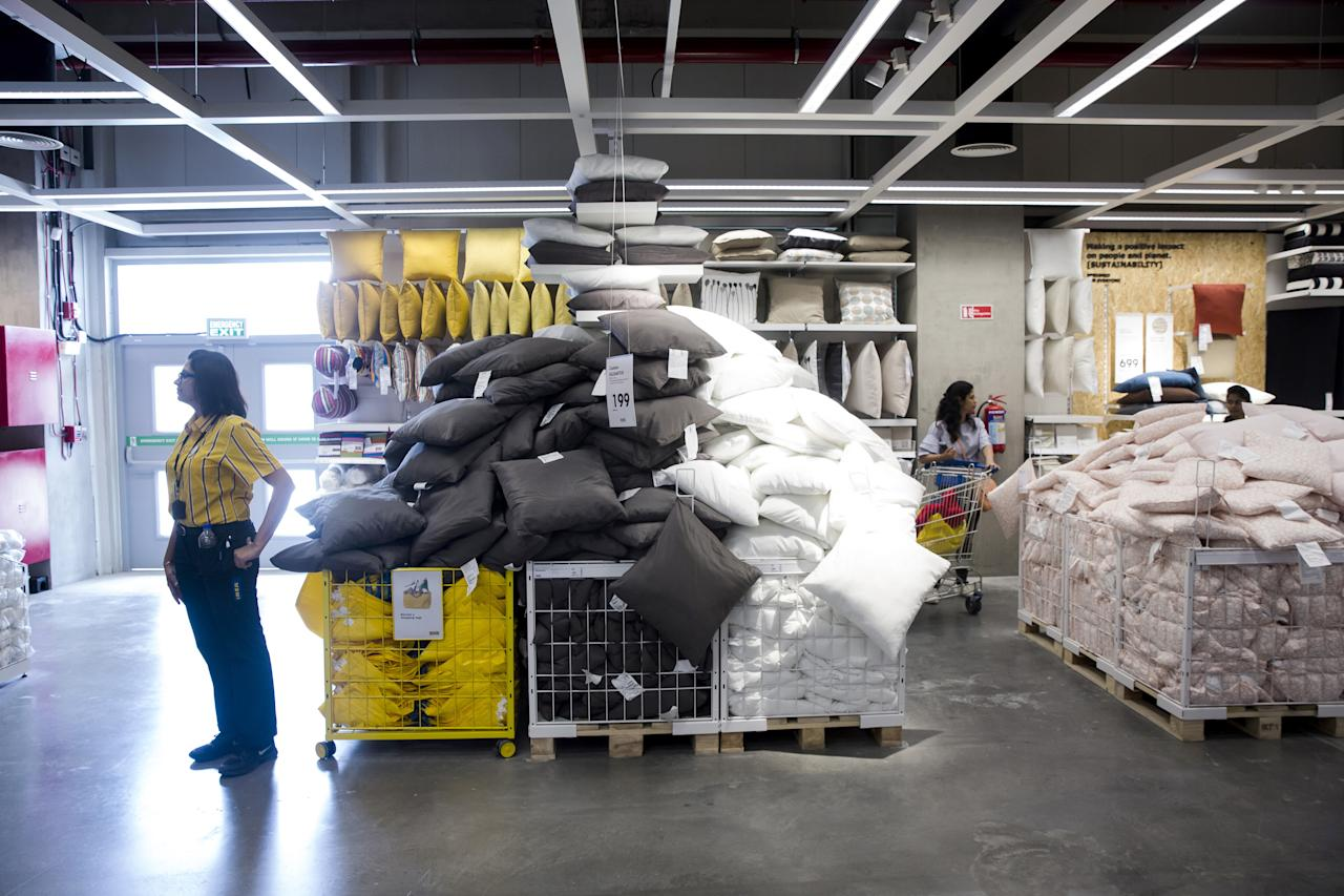 <p>An employee stands next to crates of cushions inside the Ikea store in Hitech City on the outskirts of Hyderabad, India, on Thursday, Aug. 9, 2018. Ikea's blue-and-yellow stores are instantly recognizable: iconic, monolithic and now, as India's first store throws open its doors to the masses today, operating in more than 400 stores in some 50 countries. Photo: Udit Kulshrestha/Bloomberg via Getty Images </p>