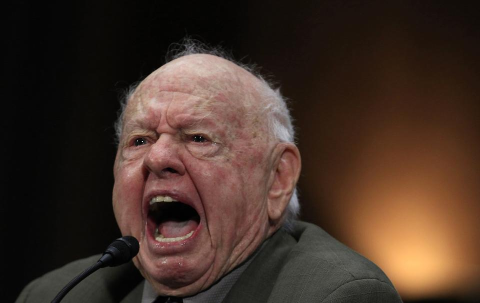 Actor Mickey Rooney speaks at a Senate hearing on elder abuse, neglect and financial exploitation on Capitol Hill in Washington in this March 2, 2011 file photo. Rooney, the pint-sized screen dynamo of the 1930s and 1940s best known for his boy-next-door role in the Andy Hardy movies, died on April 6, 2014 at 93, the TMZ celebrity website reported. It did not give a cause of death and a spokesman was not immediately available for comment. REUTERS/Jim Young/Files (UNITED STATES - Tags: ENTERTAINMENT OBITUARY)
