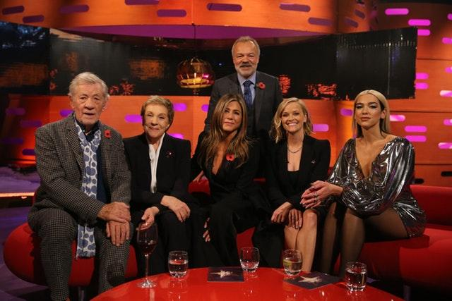 Host Graham Norton with (seated left to right) Sir Ian McKellen, Dame Julie Andrews, Jennifer Aniston, Reese Witherspoon and Dua Lipa