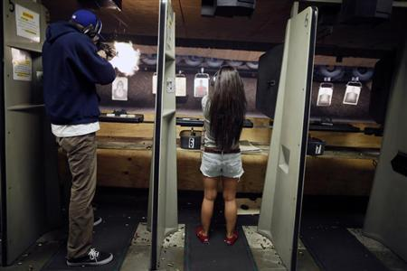 People fire at targets at the Los Angeles gun club in Los Angeles