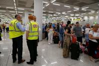 British government officials are seen at Thomas Cook check-in points at Mallorca Airport after the world's oldest travel firm collapsed, in Palma de Mallorca