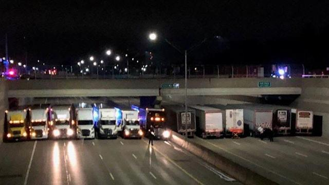 A group of truckers in Michigan helped prevent a man from committing suicide on a busy highway. (Photo: Twitter mspmetrodet)