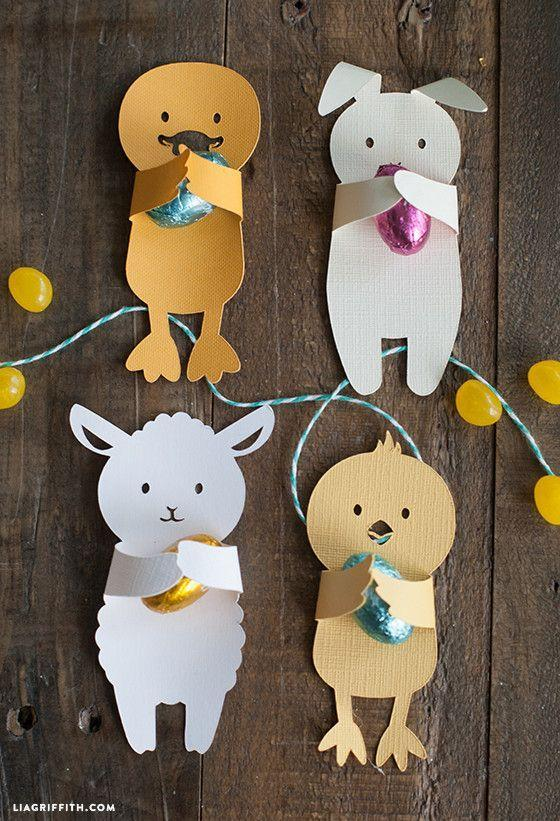 """<p>Let kids cut out their favorite animal shapes (or download Lia Griffith's here), then place a candy on them to gift to friends or teachers. </p><p><strong>Get the tutorial at <a href=""""https://liagriffith.com/diy-easter-candy-huggers/"""" rel=""""nofollow noopener"""" target=""""_blank"""" data-ylk=""""slk:Lia Griffith"""" class=""""link rapid-noclick-resp"""">Lia Griffith</a>.</strong></p>"""