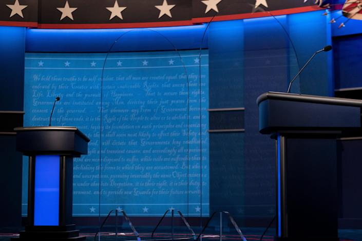 Clear dividers are seen on stage as preparations are made for the final presidential debate between President Donald Trump and former Vice President Joe Biden (Photo by BRENDAN SMIALOWSKI/AFP via Getty Images)