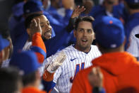 New York Mets' Jeff McNeil celebrates in the dugout after hitting a home run against the Arizona Diamondbacks during the third inning of a baseball game Saturday, May 8, 2021, in New York. (AP Photo/Noah K. Murray)