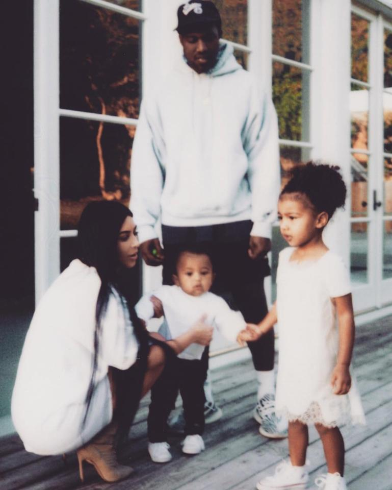 """Family,"" Kim wrote on her first post in three months, featuring—well, her family."