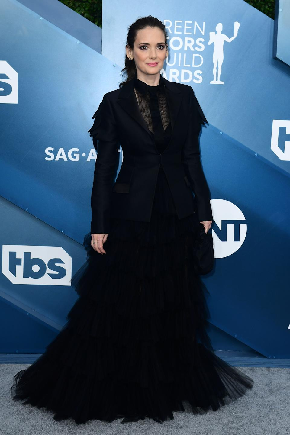 <h2>Winona Ryder in Dior</h2><br>Winona Ryder is bringing back her coveted '90s all-black looks in this sheer blazer-dress combo.