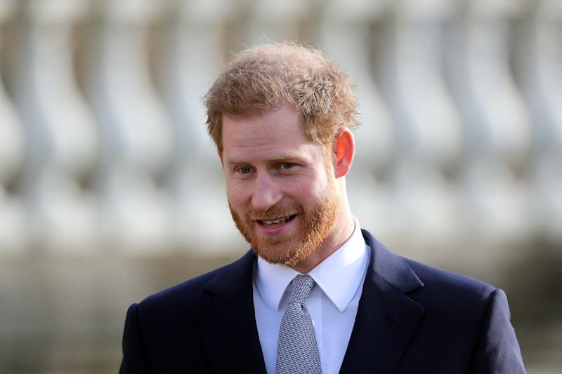 """Prince Harry expressed """"great sadness"""" over his and Duchess Meghan's decision to step back from their royal duties in his first speech since making their bombshell announcement."""