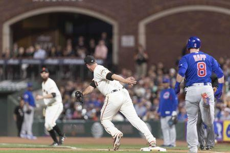 Jul 9, 2018; San Francisco, CA, USA; San Francisco Giants relief pitcher Tony Watson (56) forces out Chicago Cubs left fielder Ian Happ (8) at first base during the seventh inning at AT&T Park. Mandatory Credit: Neville E. Guard-USA TODAY Sports