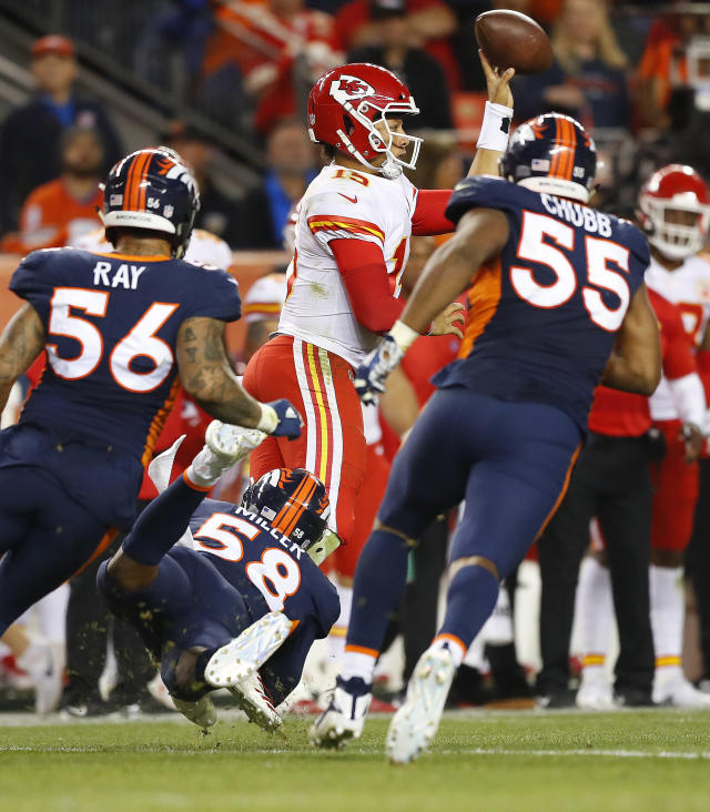 Kansas City Chiefs quarterback Patrick Mahomes (15) throws left handed for the first down as Denver Broncos linebacker Bradley Chubb (55) and linebacker Shane Ray (56) pursue during the second half of an NFL football game, Monday, Oct. 1, 2018, in Denver. (AP Photo/Jack Dempsey)