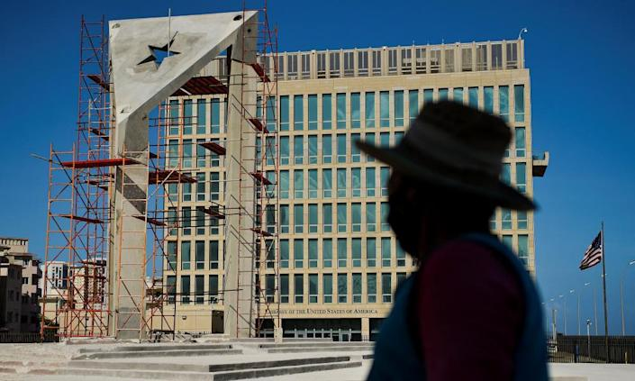 A worker looks at a huge concrete Cuban flag being built in front of the US embassy in Havana last month.