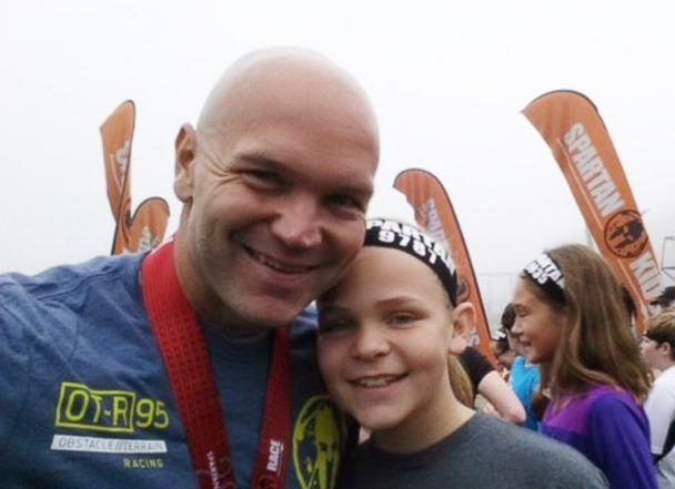 PHOTO: Andy Bell, 45, poses with one of his daughters after completing a Spartan race. (Andy Bell)