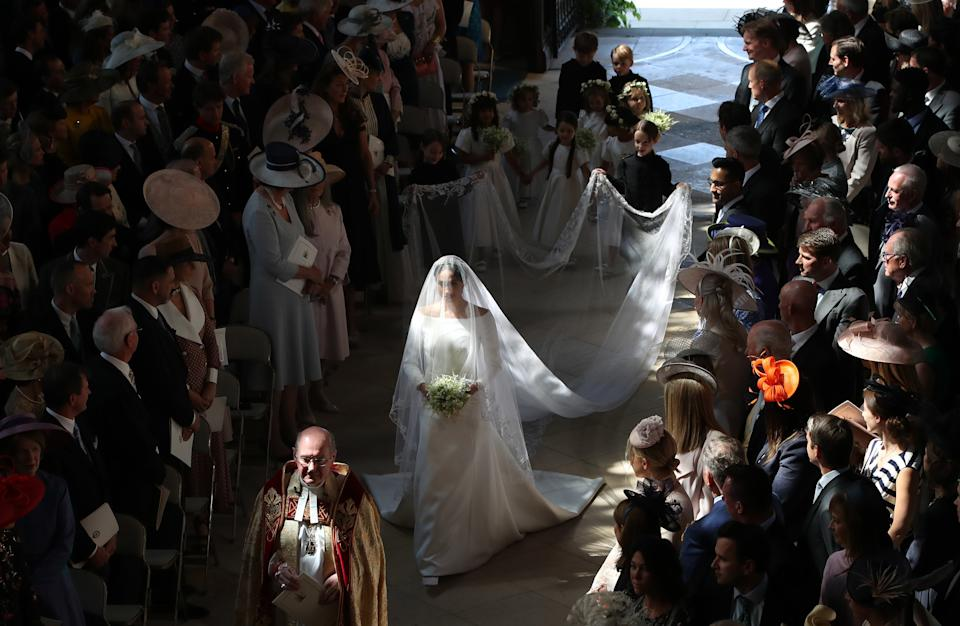 WINDSOR, UNITED KINGDOM - MAY 19:  Meghan Markle and her bridal party walk down the aisle of St George's Chapel at Windsor Castle for the wedding to Prince Harry on May 19, 2018 in Windsor, England. (Photo by Danny Lawson - WPA Pool/Getty Images)
