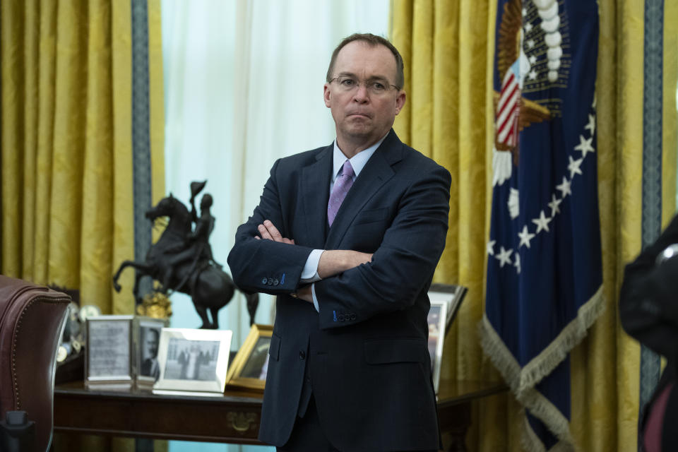 White House chief of staff Mick Mulvaney listens during a meeting between President Donald Trump and Rep. Jeff Van Drew, D-N.J., who is planning to switch his party affiliation, in the Oval Office of the White House, Thursday, Dec. 19, 2019, in Washington. (AP Photo/ Evan Vucci)