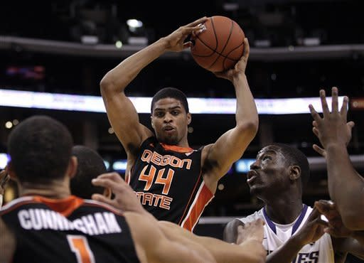 Oregon State's Devon Collier, center, looks to pass during the second half of an NCAA college basketball game against Washington at the Pac-12 conference championship in Los Angeles, Thursday, March 8, 2012. Oregon State won 86-84. (AP Photo/Jae C. Hong)