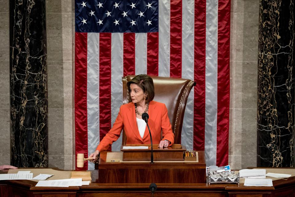 House Speaker Nancy Pelosi wields the gavel Thursday as the House votes 232-196 to pass a resolution allowing the impeachment procedure to move forward. (Photo: Andrew Harnik/ASSOCIATED PRESS)