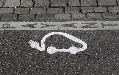 FILE PHOTO - The pictogram of an electric car is painted on a parking space in Strasbourg, April 26, 2010. REUTERS/Vincent Kessler