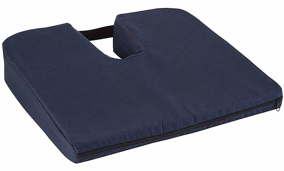 Coccyx cushion for arthritis pain.