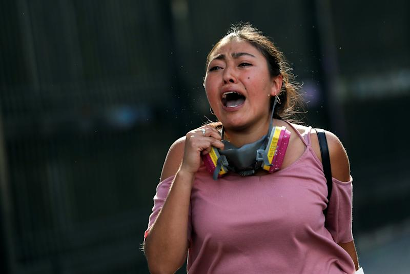 A woman reacts during an anti-government protests in Santiago, Chile Oct. 28, 2019. (Photo: Henry Romero/Reuters)