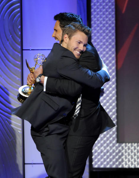 "Scott Clifton, left, from the cast of ""The Bold and the Beautiful,"" is congratulated by Don Diamont, after Clifton won the award for outstanding supporting actor in a drama series at the 40th Annual Daytime Emmy Awards on Sunday, June 16, 2013, in Beverly Hills, Calif. Don Diamont presented the award. (Photo by Chris Pizzello/Invision/AP)"