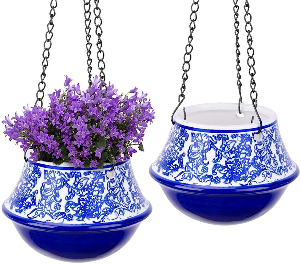 <p>Bring a dash of color into your decor with the <span>UERMEI Ceramic Blue and White Floral Hanging Planters</span> ($24)</p>
