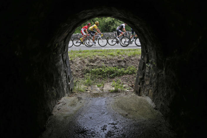 <p>Belgium's Greg van Avermaet, wearing the overall leader's yellow jersey, rides in the breakaway group during the seventh stage of the Tour de France cycling race over 162.5 kilometers (100.7 miles) with start in L'Isle-Jourdain and finish in Lac de Payolle, France, July 8, 2016. (Photo: Christophe Ena/AP) </p>