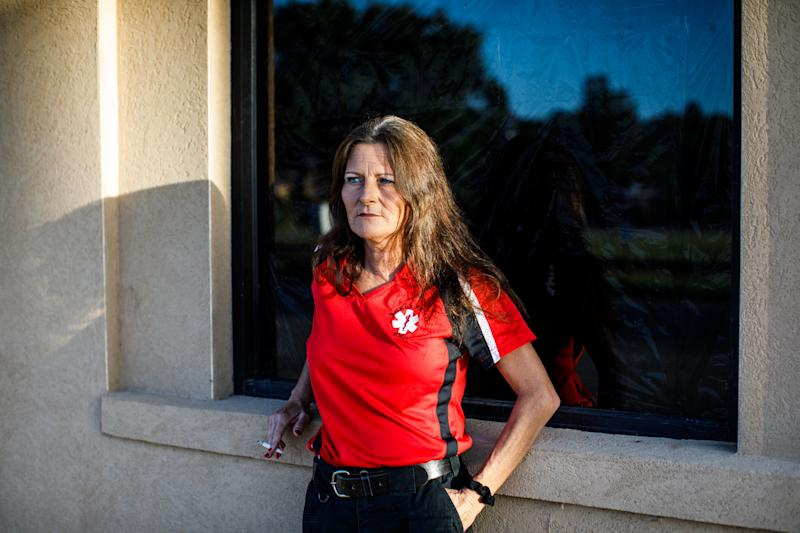 Selena Howell, the director of EMS for Wheeler County, smokes a cigarette outside the Glenwood City Hall and Fire Station. (Dustin Chambers for HuffPost)