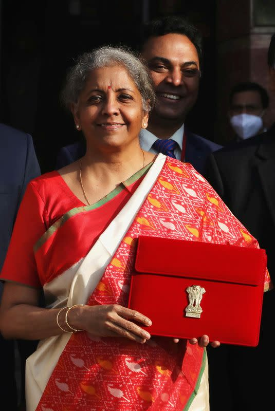 FILE PHOTO: India's Finance Minister Nirmala Sitharaman holds up a folder with the Government of India logo, as she leaves her office to present the federal budget in the parliament in New Delhi