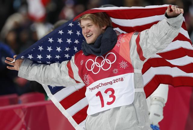 Kyle Mack of the U.S. celebrates with his national flag. (REUTERS)