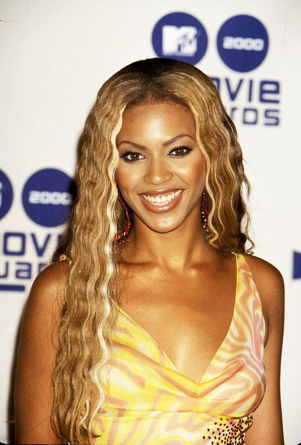 """<p>Leaving behind the crazier styles of the '90s, the 2000s started to see more wearable colors and cuts like Beyonce's wavy, <a href=""""http://www.goodhousekeeping.com/beauty/hair/news/g2443/blonde-hair-color-ideas/"""" rel=""""nofollow noopener"""" target=""""_blank"""" data-ylk=""""slk:honey blonde"""" class=""""link rapid-noclick-resp"""">honey blonde</a> hair.</p>"""