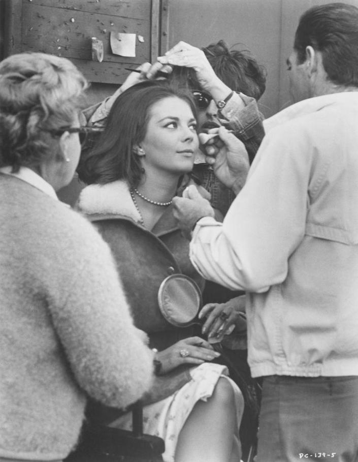 <p>Natalie Wood is descended upon by a team of makeup and hairstylists, who were tasked with touching the actress up on the set of <em>The Property is Condemned. </em></p>