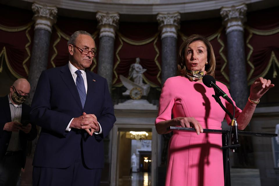 WASHINGTON, DC - AUGUST 07:  U.S. Speaker of the House Rep. Nancy Pelosi (D-CA) and Senate Minority Leader Sen. Chuck Schumer (D-NY) speak to members of the press after a meeting with Treasury Secretary Steven Mnuchin and White House Chief of Staff Mark Meadows at the U.S. Capitol August 7, 2020 in Washington, DC. Treasury Secretary Steven Mnuchin, Speaker of the House Rep. Nancy Pelosi, Senate Minority Leader Sen. Chuck Schumer and White House Chief of Staff Mark Meadows were unable to reach a deal on a new relief package to help people weather the COVID-19 pandemic.  (Photo by Alex Wong/Getty Images)
