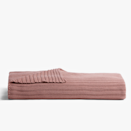 """Chunky knit, nap-ready, and in a Santa Fe-inspired rose clay? Say less. $99, Parachute. <a href=""""https://www.parachutehome.com/products/oversized-knit-throw?opt-color=clay"""" rel=""""nofollow noopener"""" target=""""_blank"""" data-ylk=""""slk:Get it now!"""" class=""""link rapid-noclick-resp"""">Get it now!</a>"""