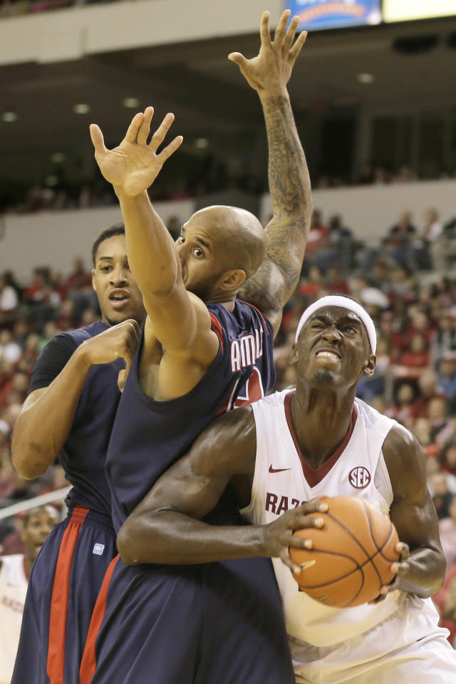 Arkansas' Bobby Portis, right, goes behind South Alabama's Mychal Ammons, center, and Augustine Rubit, left, in the first half of an NCAA college basketball game in North Little Rock, Ark., Saturday, Dec. 21, 2013. (AP Photo/Danny Johnston)