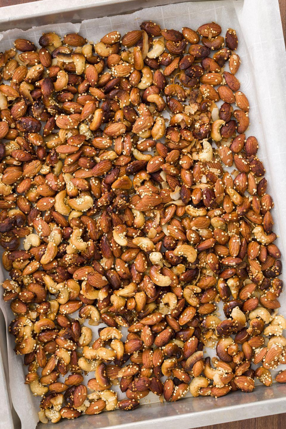 """<p>Battle hunger with this simple sweet-spicy nut mix of quinoa, honey, cayenne, and ginger.</p><p>Get the recipe from <a href=""""https://www.delish.com/cooking/recipe-ideas/recipes/a45381/sweet-n-spicy-nuts-recipe/"""" rel=""""nofollow noopener"""" target=""""_blank"""" data-ylk=""""slk:Delish"""" class=""""link rapid-noclick-resp"""">Delish</a>.</p>"""