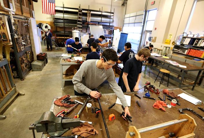 "<span class=""caption"">Students work in the plumbing shop at Worcester Technical High School.</span> <span class=""attribution""><a class=""link rapid-noclick-resp"" href=""https://www.gettyimages.com/detail/news-photo/students-work-in-the-plumbing-shop-at-worcester-technical-news-photo/626306880?adppopup=true"" rel=""nofollow noopener"" target=""_blank"" data-ylk=""slk:Boston Globe/Getty Images"">Boston Globe/Getty Images</a></span>"