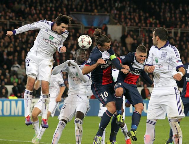 Anderlecht's Sacha Kljestan, left, PSG's players Zlatan Ibrahimovic, center, and Marco Verratti, 2nd right, try to head the ball while Anderlecht's Luka Milivojevic, right, looks on during their Champions League group C soccer match between Paris Saint Germain and Anderlecht in Paris, Tuesday, Oct. 5, 2013. (AP Photo/Michel Euler)
