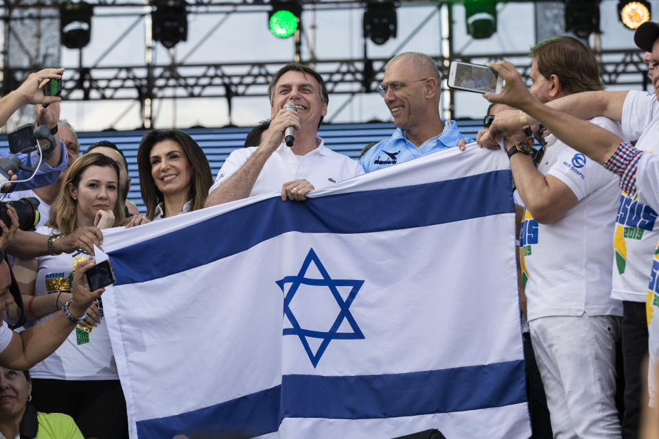 SAO PAULO, BRAZIL - JUNE 20: Brazil's President Jair Messias Bolsonaro speaks alongside of Israel's ambassador Yossi Shelley during their participation  at March for Jesus on June 20, 2019 in Sao Paulo, Brazil. (Photo by Rebeca Figueiredo Amorim/Getty Images)