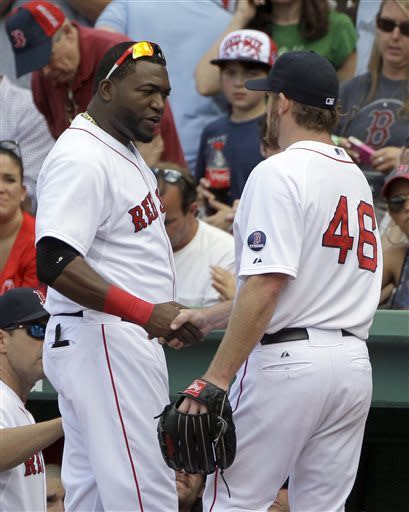 Boston Red Sox's David Ortiz, left, congratulates starting pitcher Ryan Dempster (46) as he comes out of the game after the top of the sixth inning of a baseball game against the Los Angeles Angels, Sunday, June 9, 2013 at Fenway Park in Boston. (AP Photo/Mary Schwalm)